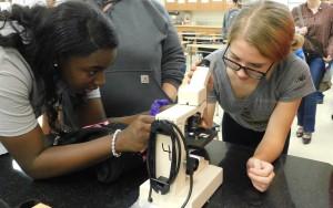 Morgann helping student